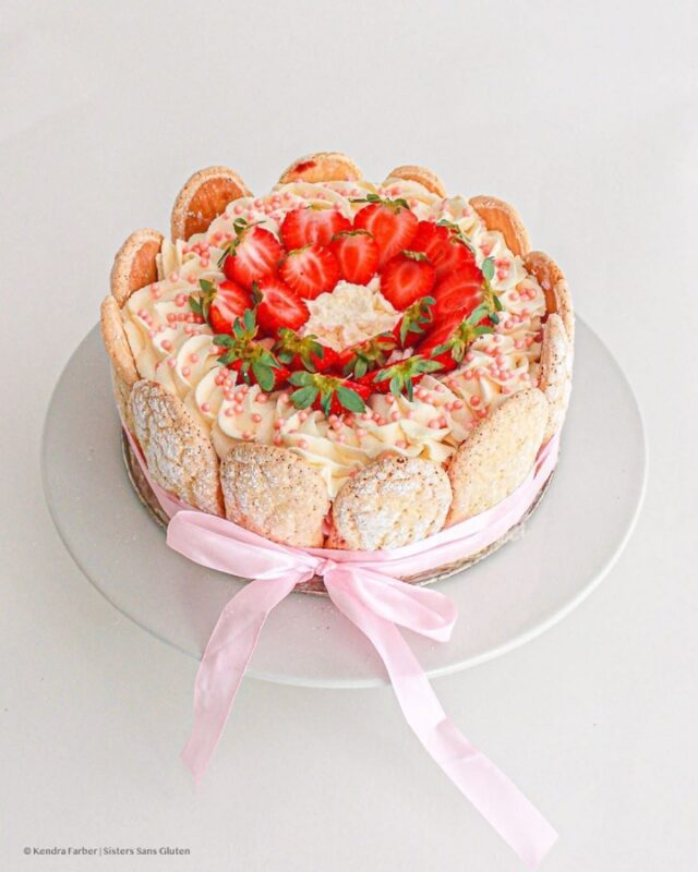 pink charlotte cake with strawberries