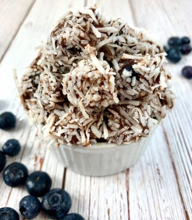 cup of blueberries with simply delish chocolate and coconut